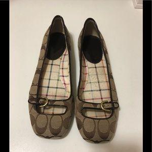 Beautiful coach flat shoes .